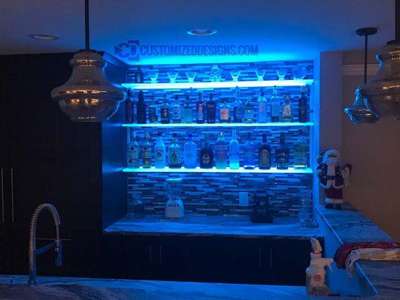LED Floating Shelves Against Tile Backsplash